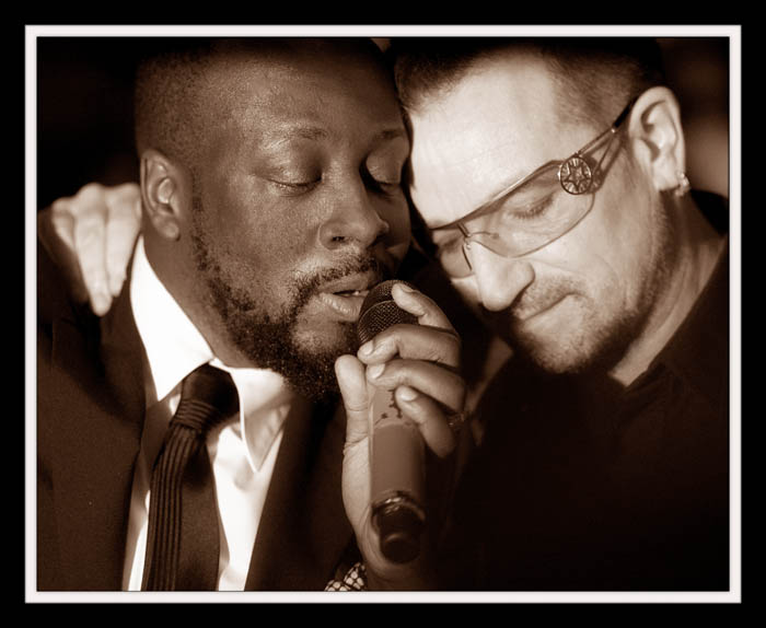 Wyclef Jean and bono singing